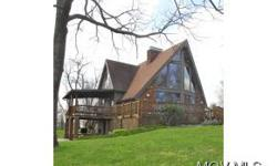 PRIVATE! New hickory laminate flooring. If you are looking to live in the woods in a beautiful Large Double A-Frame home on approximately 9+ acres in Morgan County, OH. Here it is! Property includes natural gas well providing free gas for the home. Inside