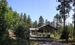 """Incredible Living Space of close to 4000 total Finished sqft! Outdoor Living at it's best with Timbered and composite decking that nearly wraps the home! Beautiful Open floor plan with """"Picture"""" windows that over look the Private Acreage! Well done"""