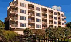 Like living in a resort community! This beautiful, waterfront condominium offers inspiring views from nearly every room. And it's neat as a pin. Hardwood floors throughout. Speakers throughout the residence. This is trouble-free living indeed. The