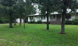 Mobile Home with 3/4 of an acre land, a 16x16 bedroom added on the back, has a metal roof over it with a carport, front porch and a deck on the back. Has a storage building, Comes with a side by side refrigerator and self cleaning stove. For more
