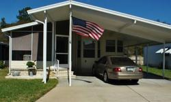 This is a 1993 double wide home with 2 bedrooms and 2 bathrooms for $32,000. It has a 2 car carport with a 9ft shed. It comes with plenty of closet space, a screened in frontpatio, 2 dining areas, a utility room, semi-furnished with washer/dryer, Kitchen