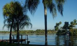 """""""BUY THIS HOME AND WE'LL BUY YOURS"""" *Beautiful waterfront home with stunning unobstructed views over the river. Gulf access, covered boat dock, quiet area, too many features to list. View the home's website and online virtual tour at http"""
