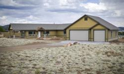 A Beautiful 3 bedroom 2 bath open floor plan 1875 sq. ft. home with panoramic views of the mountains. Sitting on a stunning 3.64 acres!! Horses ok, Access to unending miles of forestry land to the North of the property. http