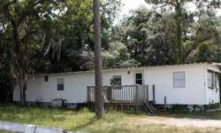 This is a 2 bedroom 2 bath mobile home in the moon lake area of new port richey. We're asking 35,000 dollars for this house. This home has a well and septic and a nice front porch. this mobile home also has an aluminum roof over .The adjoining property is