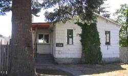 This HUD home has lots of potential! 2 bedroom, 1 bath with hardwood floors in the living room and tile floors in the bath. Home needs considerable work. Detached garage and greenhouse. Eligible for FHA financing with escrow repairs of $4950. Sold As Is .