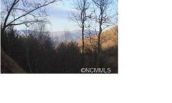Magnificent views abound from this 2.63 acre ridge top lot!