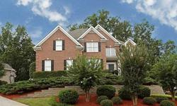 ~ Bright Two Story Entry Foyer flanked by elegant Formal Living Room and Banquet Dining Room~ Gleaming Hardwoods throughout the Main Level~ Gourmet Kitchen with Breakfast Bar, Solid Surface Countertops, Double Ovens, Gas Cooktop and Spacious Breakfast