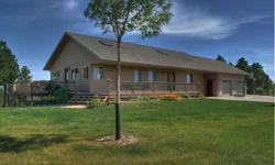 This beautiful house and land comes with a mature tree belt with a water drip system in the front yard and a gently sloping back yard with mature pine trees and beautiful views.The wrap-around front porch affords the opportunity to view Mt Rushmore in
