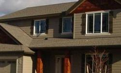 The Saratoga by Paras Homes in fabulous Eagle Ridge! Beautiful 4 bedroom 2 and a half bathroom 3,648 square foot home with 4 car garage and full unfinished basement. Great room floor plan with open dining, living, and kitchen areas plus formal dining room