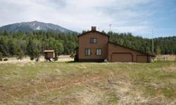 Less than 20 minutes from Flagstaff City limits to the opportunity you are dreaming of...This terrific mountain home backs National Forest lands with unobstructed views of the San Francisco Peaks. Located off the grid, this home is self-sufficient with