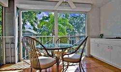 Well maintained spacious 2 bedroom + den, 2 full bath end unit with a detached garage provides privacy overlooking a lovely waterscape view from 1 of 2 screened lanais with electric hurricane shutters. This condo is move in ready and features plantation