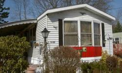 14 X 70 mobile home. 2 Large bedrooms with wall/wall closets, Front living room with room for desk area, bay windows facing south, great sun exposure in winter, aluminum siding, pitched roof (new last year), regular storm windows, easy to heat. new hot