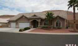 Step inside this Spanish Trails Estates home and be amazed! This 3700 square foot home features an open floor plan between the dining, kitchen and living area. The master bedroom features a large jetted tub with beautiful tile to accent the floors and