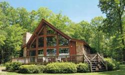 DONT PASS THIS ONE UP!!! Wonderful vacation property sitting on a little more than a acre of natural woods and mature trees. This property is currently generating rental income, is well decorated and comfortably furnished. It is located in the popular