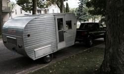 1959 Easy Travler Trailer, Road ready, easy to tow12 foot. Recently replaced bearings and re-packed wheels on the trailer.Original wood interior, propane cooktop included as well as ice box, 6' interior, Exterior Door