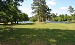 LOT IS NESLTED IN WINDMILL ESTATE.VIEWS OF 2 LAKES IN THE HEART OF MAGNOLIA.TAKE A LOOK AND SEE...YOU WILL WANT TO BUILD YOUR DREAM HOME HERE. WALK TO THE POOL & TENNIS COURTS.MAGNOLIA ISD CLOSE TO SHOPPING AND CHURCH
