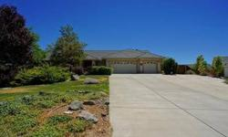 Beautifully maintained home on private 1.5 acre view lot. 1200 Square foot garage/shop. Wide concrete driveway. RV parking,spa. room for horses.Listing originally posted at http