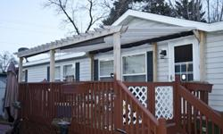 This is a very nice 1997 Homark Royal American manufactured home.The huge living room, Jacuzzi tub, french doors and large deck make this a great next home!Living room