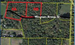 Land can be split into 2 5-acre tracts or sold as a whole. 1 tract has Mountain Breeze Dr running through it placing about 1/4 of the property on the other side of the road. This Lot has creek Through it on the other side of the road.
