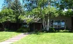 Lovely large home on desirable south hill High Drive location. Outstanding gardens, pool, hot tub. Views to west. Easy access to downtown, parks, hiking/biking trails.Listing originally posted at http