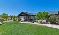 High above the valley sits this warm, inviting home on over 14 acres. Enjoy majestic views, miles of riding trails and peaceful country living - only 20 minutes from downtown Reno. The interior exudes casual class and features numerous upgrades and large