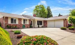 Charming rambler on a gorgeous lot surrounded by vibrant garden beds. Fenced yard with generous patio, covered BBQ area, lawn & Cascade views. Living/dining great room with built-ins, brick fireplace, brilliant hardwoods, expansive windows & a slider to
