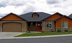 Absolutely Stunning Custom built home with over 5200 square feet with 3 finished levels. Two large decks capture the views peeking into downtown Spokane. This home is wired for all your home theatre and electronic needs. The custom wine rooms awaits your