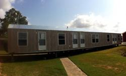 NEW FLOOR PLAN GREAT FOR CREW HOUSING. 4 INDIVIUAL BEDROOMS WITH SEPARATE BATHROOMS, WALK-IN CLOSESTS, FRONT DOOR ENTRANCES. COMMON KITCHEN AND LIVING ROOM. PERFECT FOR OILFIELD HOUSING, HUNTING CABIN, RANCH HAND OR RENTAL. COME OUT AND TOUR OUR MODEL.