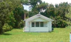 This 1950 Bungalow is set back from the road and offers over 1/4 acre of land. Offers 3 bedrooms, 1 bath and inside laundry area. The kitchen has been remodeled and new laminate and tile flooring throughout the house. Roof replaced in 2007.Listing