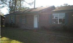 The bones are here to make this your family's new home! Seller has had the walls freshly painted. All that is needed is a little TLC and this 3/2 brick is all yours! Location is extremely convenient! In addition to the living room, there is also a HUGE