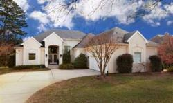 Walk through the beveled glass double front doors to enjoy a beautiful home and great view of Lake Norman. This custom ranch in The Peninsula includes a GR w/fireplace, gleeming hardwood floors, living room plus upstair bonus get away. Arched entrance to