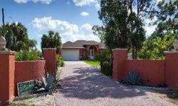 Beautiful custom built 2009 4 Bedroom home on 4.5 Acres! Centrally located between Marco Island and Downtown Naples. Very private property with lush landscaping and mature fruit trees. Features a full guest suite with it's own kitchen and bath. Granite