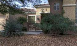 This Sun City Anthem home is the popular Anthem model with wrap around view windows looking out from its elevated lot over the city, valley & mountains. Gated court yard entry, large master suite with double walk-in closets, huge living & dining room with
