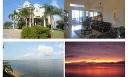 """""""Heaven's a little closer in a home by the sea"""" and you'll think you're half way there when you wake up in this exqusite home. Your rear neighbors are manatee and dolphins and the sunsets are free! Come and experience a million dollar view for a fraction"""