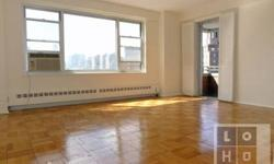 Spacious living room with triple-width picture window offering views of the downtown Manhattan Skyline. If you prefer, step out onto the balcony and enjoy the view from there. The eat-in kitchen has a full size window plus pass-thru window to the balcony.