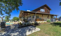 HILLTOP PARADISE!! The hill country at its best, this equine friendly 10.13AC 3/2.5 2120 sq ft home and property has it all. Enjoy the infinity pool/hot tub, or just sitting along the wrap around deck, listening to the outdoor stereo system. This home has
