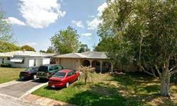 This 2 bedroom, 2 bath, 1 car garage home is located in Magnolia Valley, a community in New Port Richey, Florida. The property has mature landscaping with fruit trees, sliding doors, an open/covered front porch and a sidewalk. The home has ceramic tile