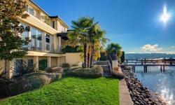 Premier waterfront estate on Lake Ave West with rare, level 97' of shoreline & private dock with boat lift. Custom built in 1999 by Hamish Anderson with the finest quality materials & craftsmanship. Ideal floor plan perfect for entertaining. Expansive