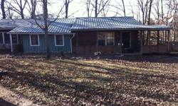 FOR SALE, 2 or 3 bedroom w/ 2 baths located between Edgar Springs MO and Highway J. Beautiful home sits on 2 1/2 acres, completely fenced, with several outside bulidings that have electic and water to most. Very large pond (lake) in backyard, fully