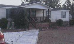 A pristine house on .70 acres. The brick underpinned home, located a few minutes from Lexington, churches, schools and shops, has a front porch and huge back deck. Deck has excellent view of spacious yard that includes manicured lawn, fruit trees &