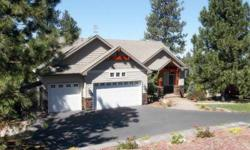 Custom Daylight Craftsman on over 1 acre in the Broadmoor Estates. New granite slab counter tops and custom stone tiled backsplash. 2nd bedroom on the main floor is an office with closet area. Vaulted great room with floor to celing windows. Formal