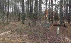 Mixed woods on this gently sloping 2.39 acre lot minutes to Carrboro. Call CSS to register to show. Thanks