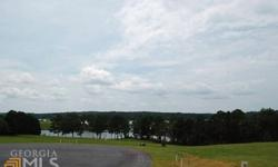 Lake view lot in the new oconee landing subdivision with electronic gated entrance, community boat ramp and docks, boat storage to be built, volleyball area, walking trails, three interior ponds with some gazebos, paved roads, hoa.
