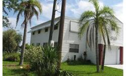 """""""Welcome to 6537 Tower Dr."""" Unique Waterfront Stilt Home with Gulf Access. Great Room Plan with 2 Bedrooms & 2 Bathrooms. Spacious Kitchen & Dining Room. 2 Car Garage with Work Shop. Other features include Sun Deck, Patio, Concrete Sea Wall, & Floating"""