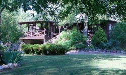 Enjoy peace and tranquility on Lookout Mountain. Privacy is assured in this mountain home which includes a wrap around deck and large gazebo. This 2 bdrm, 1 1/2 bath home has a partial basement and carport and numerous out buildings for storage. Home is