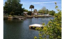 One large 1/4 acre (MOL) lot or 3 small residential cul-de-sac lots on a salt canal in Hudson, Florida with boat access to the Gulf of Mexico. Property has a floating dock and no existing house. Purchase this lot and build the home of your dreams in bea