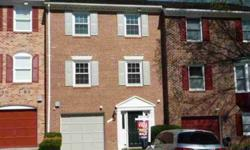 Easy living! That's what you will find in this well maintained, all brick, garage townhouse. Open LR/DR w/HW flrs, crown & chair moldings for elegant entertaining. Spacious eat-in kitchen updated w/stainless appliances. New windows to let the sun shine