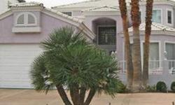 Price Reduced!! Enjoy Classic Las Vegas Charm and Convenience! IMPECCABLE CUSTOM OVERLOOKING A WATER HOLE ON THE GUARD-GATED LAS VEGAS COUNTRY CLUB GOLF COURSE JUST MINUTES FROM THE STRIP! VIKING APPLIANCES! OTIS ELEVATOR! CEDAR LINED CLOSETS! OVERSIZED