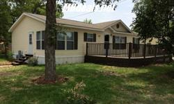 Made in 2007, this Beautiful 3 bed 2 bath Double wide manufactured home sits on a gorgeous .13 acres corner lot just within minutes of town. At 1,400 square feet (28 x 50). On the interiors you will have a Ceiling fan, Garden tub with separate shower in