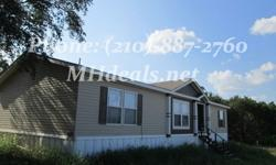 A Gorgeous Double Wide manufactured home with 5 acres of land. The land is a serene country setting, very easy to work with. The home can handle a fairly good amount of wind to a wind zone 1 criteria. The home is a big 1,568 square feet (28 x 56). This 3